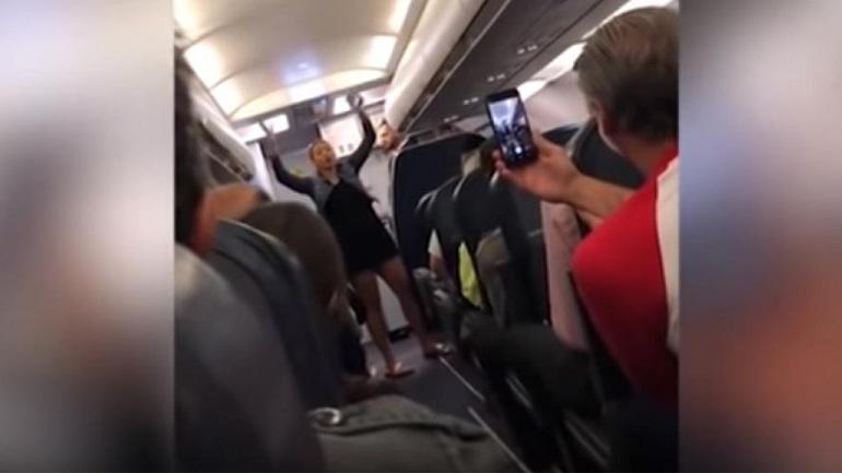 A drunk passenger shows his back